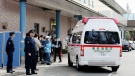 An ambulance carrying evacuees from Wuhan, China, arrives at Ebara Hospital in Tokyo Wednesday, Jan. 29, 2020 after the first group of Japanese evacuees returned from the virus-hit Chinese city. (Kyodo News via AP)