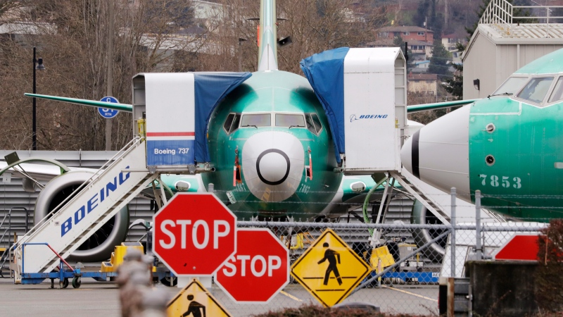 In this Dec. 16, 2019, file photo, Boeing 737 Max jets sit parked in Renton, Wash. Boeing Co. reports financial results on Wednesday, Jan. 29, 2020. (AP Photo/Elaine Thompson, File)