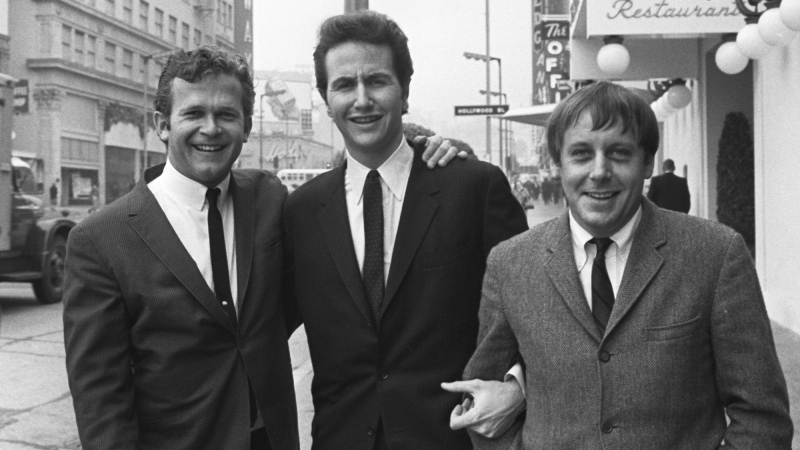 In this Jan. 31, 1967, file photo, members of the Kingston Trio, from left: Bob Shane, John Stewart and Nick Reynolds are pictured in the Hollywood section of Los Angeles. (AP Photo/File)
