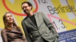 The directors of the Berlinale film festival, Carlo Chatrian and Mariette Rissenbeek, present the program of the Berlinale in Berlin, Germany, Wednesday, Jan.29, 2020. The 70th International Film Festival begins on Feb.20. (Britta Pedersen/dpa via AP)
