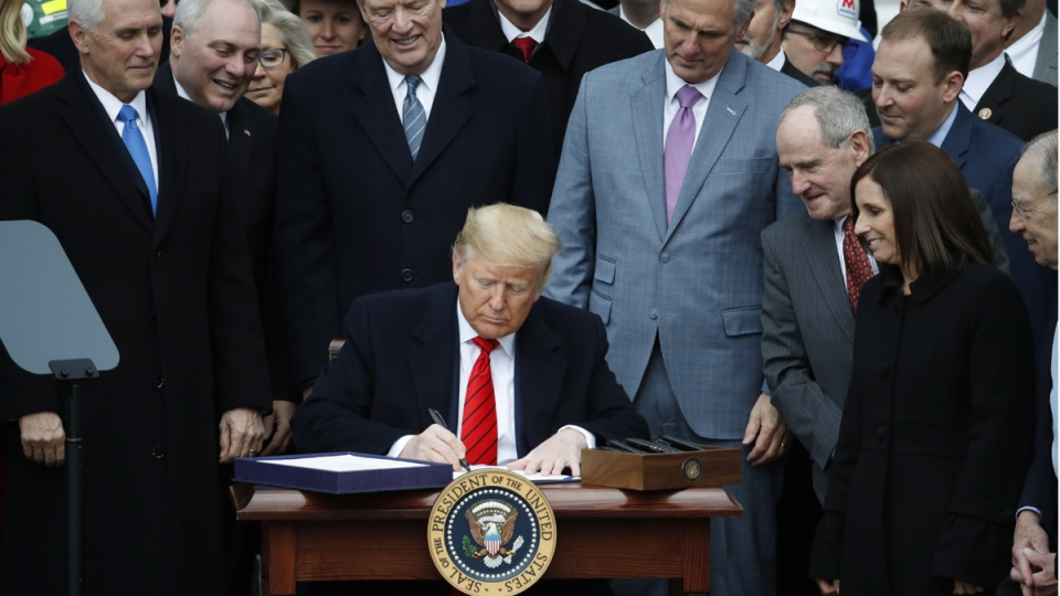 U.S. President Donald Trump signs the new NAFTA
