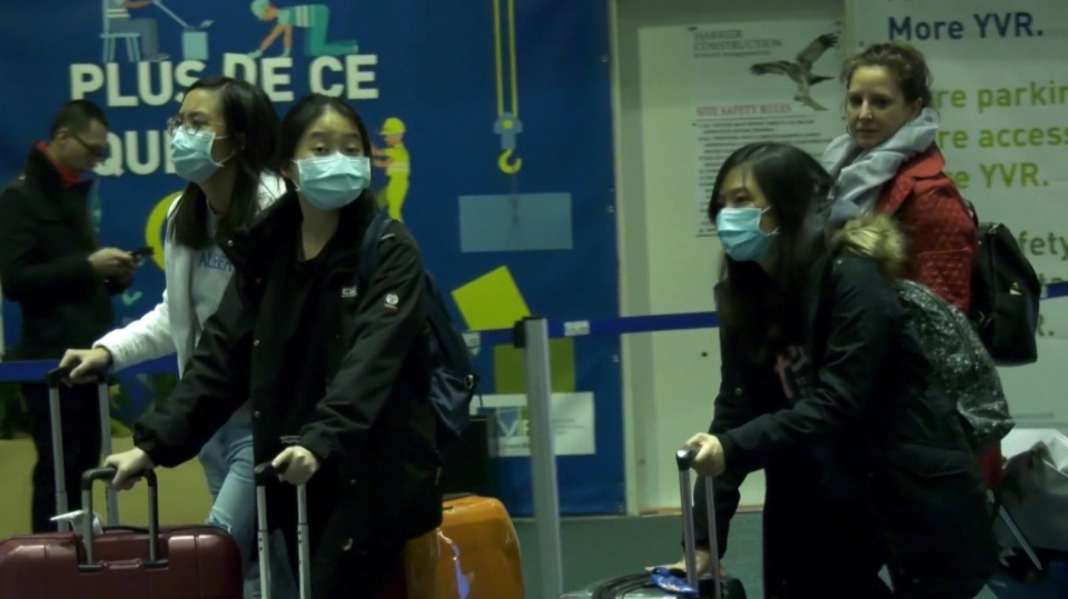 Travellers at YVR wearing face masks on Jan. 28, 2020.