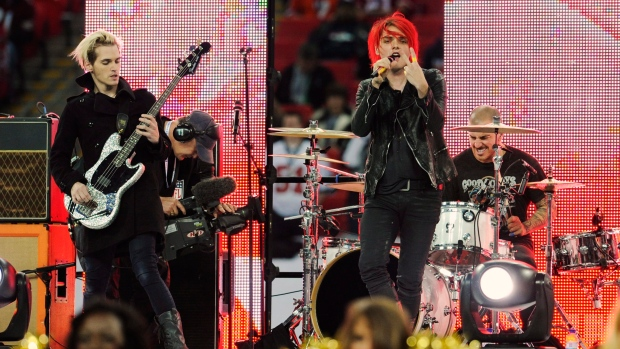 In this Oct. 31, 2010 file photo, My Chemical Romance performs during the pre-game show for the NFL Football game between the Denver Broncos and San Francisco 49ers at Wembley Stadium in London.  (AP Photo/Tom Hevezi)