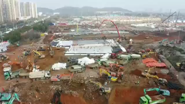 Live-streamed video shows the construction of two hospitals in the Chinese of city of Wuhan in response to the coronavirus outbreak.