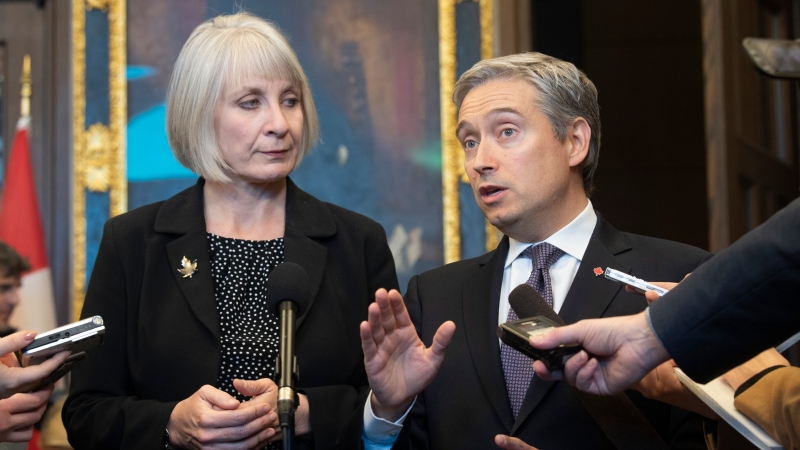Minister of Health Patty Hajdu looks on as Foreign Affairs Minister Franois-Philippe Champagne esponds to a question as they speak with the media about the coronavirus, Wednesday January 29, 2020 in Ottawa. THE CANADIAN PRESS/Adrian Wyld