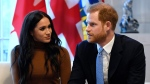 Prince Harry and Meghan, Duchess of Sussex gesture during their visit to Canada House in thanks for the warm Canadian hospitality and support they received during their recent stay in Canada, in London, Tuesday, Jan. 7, 2020. (THE CANADIAN PRESS/AP, Daniel Leal-Olivas/Pool Photo)