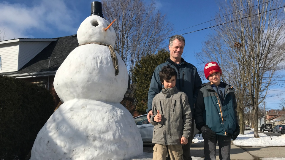 A giant snowman on a front lawn in Guelph