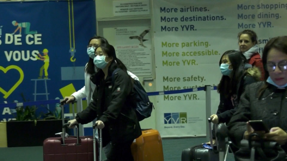 Passengers at YVR wearing masks
