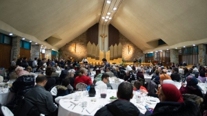 Members of the Muslim community, citizens and politicians gather inside a catholic church at a community dinner marking the commemoration of the mosque shooting Wednesday, January 29, 2020 in Quebec City. THE CANADIAN PRESS/Jacques Boissinot