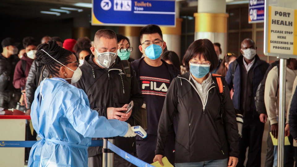 Passengers arriving on a China Southern Airlines flight from Changsha in China are screened for the new type of coronavirus, whose symptoms are similar to the cold or flu and many other illnesses, upon their arrival at the Jomo Kenyatta international airport in Nairobi, Kenya Wednesday, Jan. 29, 2020. (AP Photo/Patrick Ngugi)