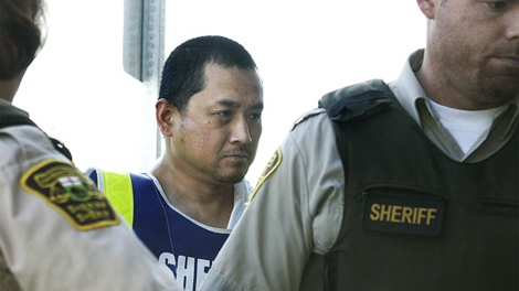 Vince Li, the accused in the Greyhound bus beheading of Tim McLean appears in a Portage La Prairie court on Tuesday, August 5, 2008. (John Woods / THE CANADIAN PRESS)