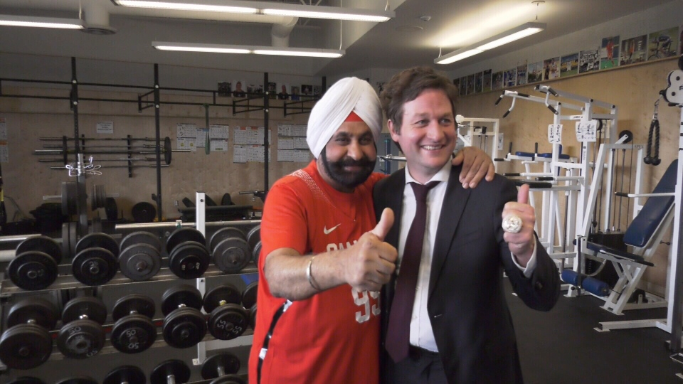 Nav Bhatia with B.C. Education Minister Rob Fleming. (CTV News)