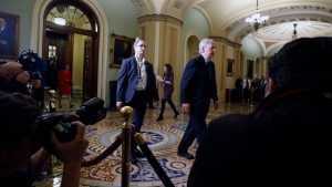 Senate Majority Leader Mitch McConnell, R-Ky., walks out of the Senate chamber past news photographers during a break in the impeachment trial of President Donald Trump at the Capitol, Thursday, Jan 30, 2020, in Washington. (AP / Steve Helber)