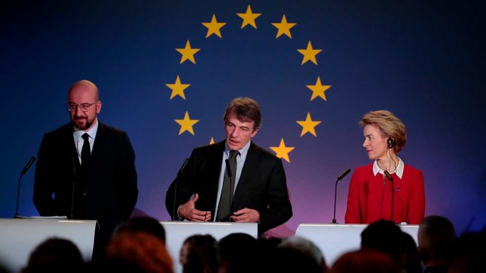 From right, European Commission President Ursula von der Leyen, European Parliament President David Sassoli and European Council President Charles Michel participate in a media conference at the Parlamentarium in Brussels, Friday, Jan. 31, 2020. The U.K. is due to leave the EU on Friday the first nation in the bloc to do so. (AP Photo/Virginia Mayo)