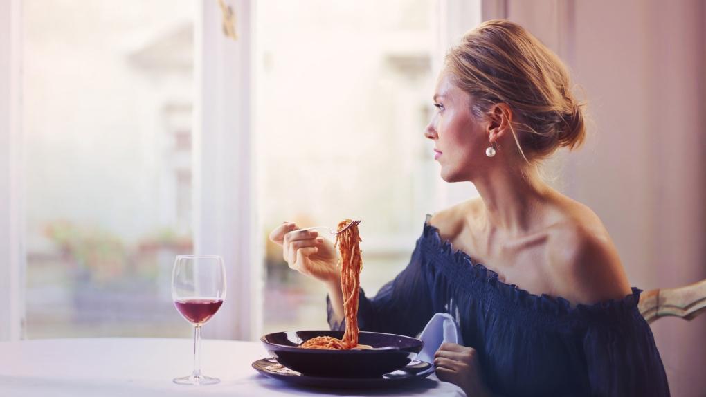 Woman and spaghetti