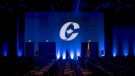 A man is silhouetted walking past a Conservative Party logo before the opening of the Party's national convention in Halifax, Thursday, Aug. 23, 2018. THE CANADIAN PRESS/Darren Calabrese