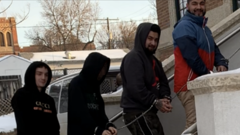 Shawn Alexander Kelly (far left), Seyed Kourosh Miralinaghi (second farthest right), and Seyed Kamran Miralinaghi (farthest right) enter Swift Current Provincial Court to address their human trafficking charges Friday. (Courtesy: Swift Current Online)
