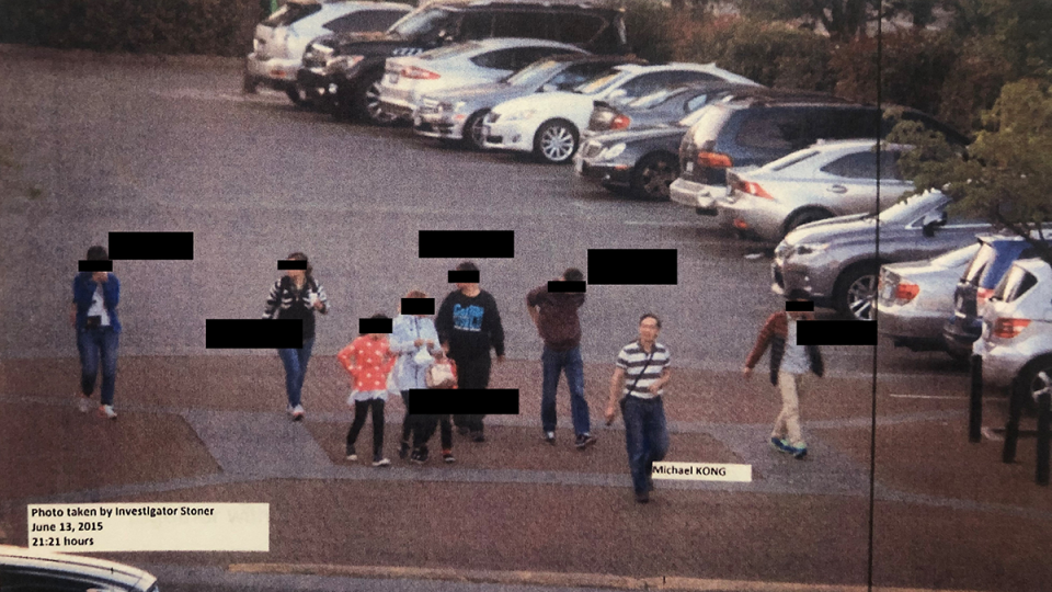 A photo shown in court shows Michael Kong walking through the parking lot of Parker Place Mall in Richmond, B.C., with a group of irregular migrants after helping them enter Canada on June 13, 2015. The exhibit was part of an agreement of facts.