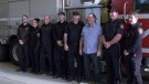 Tony Deys (in light blue shirt) with Lethbridge paramedics and firefighters, whom Deys credits with saving his life after he suffered a heart attack December 15.