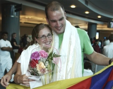 Canadian Tibet protester Melanie Raoul greets fellow protester Sam Price upon his arrival at Vancouver International Airport in Richmond, B.C., August 9, 2007. (CP / Richard Lam)
