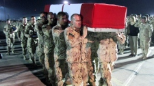 Canadian soldiers carry the casket of Pte. Jonathan Couturier during a ramp ceremony held at Kandahar Airfield in Afghanistan, Friday, Sept. 18, 2009. (Bill Graveland / THE CANADIAN PRESS)