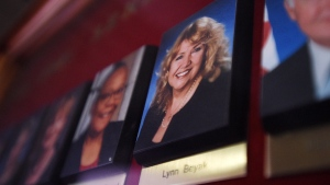 The Senate ethics committee is recommending that Sen. Lynn Beyak continue her suspension — without pay. A picture of Senator Lynn Beyak accompanies other Senators official portraits on a display outside the Senate on Parliament Hill in Ottawa on Thursday, Sept. 21, 2017. THE CANADIAN PRESS/Sean Kilpatrick