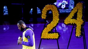 Los Angeles Lakers' LeBron James, wearing a No. 24 jersey, speaks about Kobe Bryant prior to an NBA game between the Lakers and the Portland Trail Blazers on Friday, Jan. 31, 2020, in Los Angeles. Bryant, the 18-time NBA All-Star who won five championships and became one of the greatest basketball players of his generation during a 20-year career with the Lakers, died in a helicopter crash Sunday. (AP Photo/Ringo H.W. Chiu)