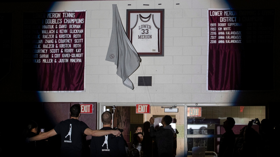 Kobe Bryant's Lower Merion jersey is unveiled in the Bryant Gymnasium during a ceremony at Lower Merion High School, Saturday, Feb. 1, 2020, in Ardmore, Pa. (Charles Fox/The Philadelphia Inquirer via AP)