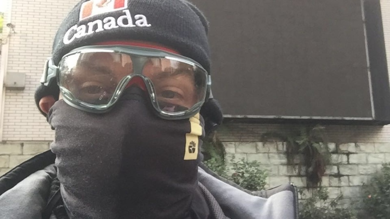 Kai Wood wears protective gear at his high school Chongqing, China. (Kai Wood)