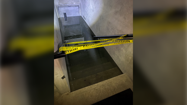 Water nearly filled the top of the door into the underground parkade.  (Peter Lam)