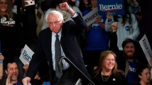 Democratic presidential candidate Sen. Bernie Sanders, I-Vt., with his wife Jane O'Meara Sanders, arrives to speak to supporters at a caucus night campaign rally in Des Moines, Iowa, Monday, Feb. 3, 2020. (AP Photo/Pablo Martinez Monsivais)