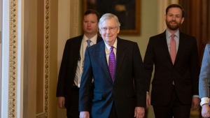 Senate Majority Leader Mitch McConnell of Ky., second from left, walks from the Senate Floor on Capitol Hill, Tuesday, Feb. 4, 2020 in Washington. (AP Photo/Alex Brandon)