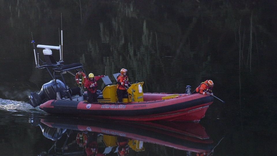 Searchers scour the Sooke River to find AJ Jensen, the last of three friends to be found after their truck entered the river. (CTV News)