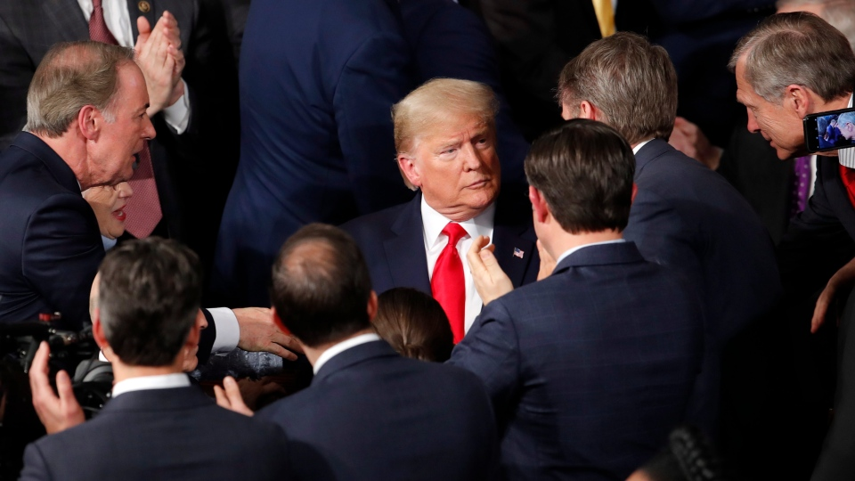 U.S. President Donald Trump arrives to deliver his State of the Union address to a joint session of Congress on Capitol Hill in Washington, Tuesday, Feb. 4, 2020. (AP Photo/J. Scott Applewhite)