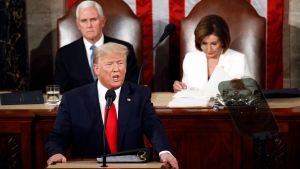 U.S. President Donald Trump delivers his State of the Union address to a joint session of Congress on Capitol Hill in Washington, Tuesday, Feb. 4, 2020, as Vice President Mike Pence and House Speaker Nancy Pelosi, D-Calif., watch. (AP Photo/Patrick Semansky)