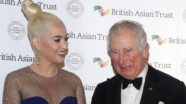 Prince Charles, Royal Founding Patron of the British Asian Trust, with Katy Perry at a reception in London, on Feb. 4, 2020. (Kirsty Wigglesworth / AP)