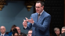 Quebec Education Minister Jean-Francois Roberge responds to the Opposition during question period Tuesday, February 4, 2020 at the legislature in Quebec City. THE CANADIAN PRESS/Jacques Boissinot