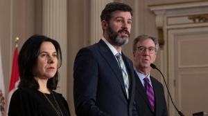 Ottawa Mayor Jim Watson and Montreal Mayor Valerie Plante stand beside Edmonton Mayor Don Iveson as he responds to a question during a news conference in Ottawa, Thursday, February 6, 2020. THE CANADIAN PRESS/Adrian Wyld