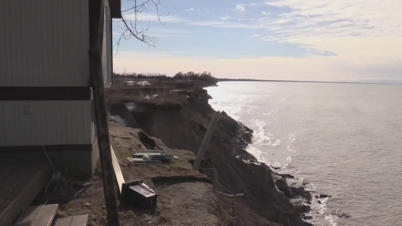 A trailer sits on the edge of a cliff after a bluff collapsed into Lake Huron near Grand Bend, Ont., Thursday, Feb. 6, 2020. (Scott Miller / CTV London)