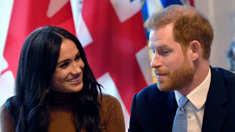 Prince Harry and Meghan, Duchess of Sussex smile during their visit to Canada House in thanks for the warm Canadian hospitality and support they received during their recent stay in Canada, in London, Tuesday, Jan. 7, 2020. (Daniel Leal-Olivas/Pool Photo via AP)