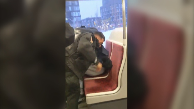A TTC Special Constable is seen involved in a violent altercation on the 501 streetcar. (Twitter/@CascadingDesign)
