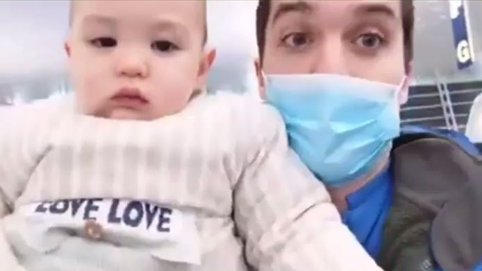 Michael Schellenburg, seen here with his son Felix, were stranded in China after the coronavirus outbreak. The