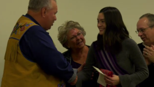 Alyssa Thomas receives a cheque from the Manitoba Métis Federation as part of the Post-Secondary Education Support Program.