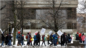 Striking teachers of the Ontario Secondary School Teachers Federation picket outside of the Toronto District School Board head office on Yonge St. in Toronto, Wednesday, Dec. 4, 2019. Ontario's elementary teachers will soon be ramping up their work-to-rule campaign by not planning any new field trips or distributing letters or memos from schools and boards. (The Canadian Press/Cole Burston)