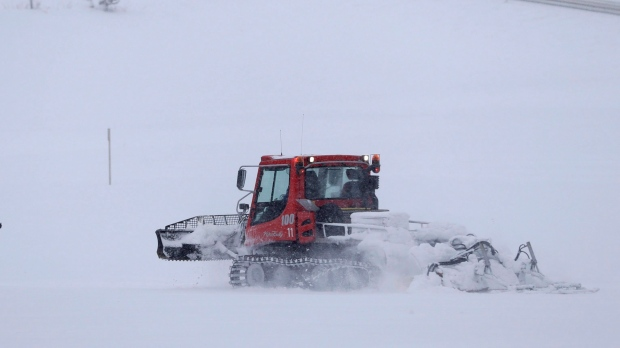 A snow groomer driver was trapped without heat overnight, suffered severe frostbite