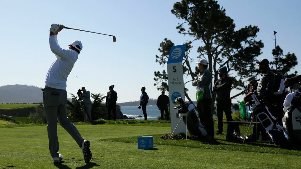 Nick Taylor, of Canada, hits from the fifth tee of the Pebble Beach Golf Links during the final round of the AT&T Pebble Beach National Pro-Am golf tournament Sunday, Feb. 9, 2020, in Pebble Beach, Calif. (AP Photo/Eric Risberg)