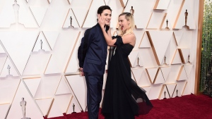 Timothee Chalamet, left, and Margot Robbie arrive at the Oscars on Sunday, Feb. 9, 2020, at the Dolby Theatre in Los Angeles. (Photo by Jordan Strauss/Invision/AP)