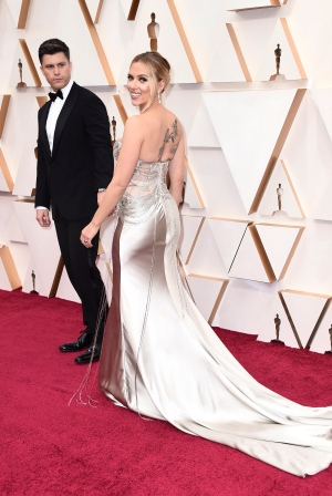 Colin Jost, left, and Scarlett Johansson arrive at the Oscars on Sunday, Feb. 9, 2020, at the Dolby Theatre in Los Angeles. (Photo by Jordan Strauss/Invision/AP) <br> <br> <b>Gallery sponsored by Wonder Bread</b>