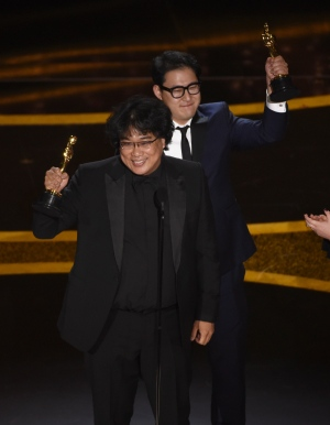 "Bong Joon Ho, left, and Han Jin Won accept the award for best original screenplay for ""Parasite"" at the Oscars on Sunday, Feb. 9, 2020, at the Dolby Theatre in Los Angeles. (AP / Chris Pizzello) <br> <br> <b>Gallery sponsored by Wonder Bread</b>"