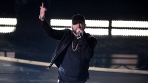 Eminem performs 'Lose Yourself' at the Oscars on Sunday, Feb. 9, 2020, at the Dolby Theatre in Los Angeles. (AP Photo/Chris Pizzello)